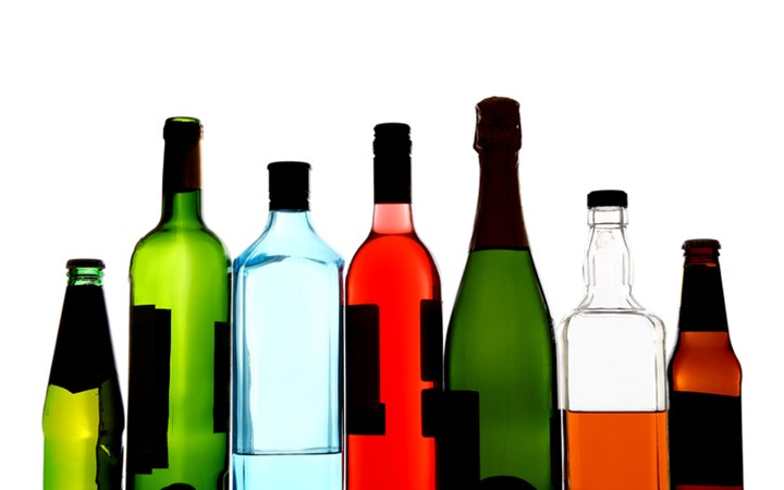 Seven bottles of non-descript alcohol including beer, wine and spirits