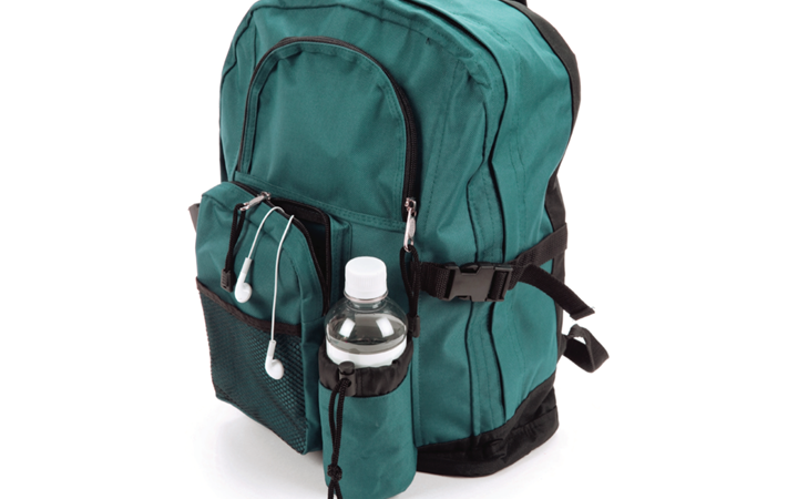 A green backpack with water bottle