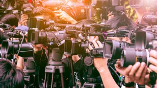 A number of television news cameras gathered