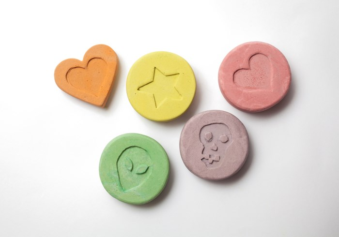 Five large bright ecstasy tablets