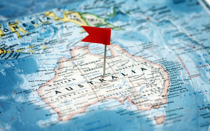 Map of australia with a red flag on top