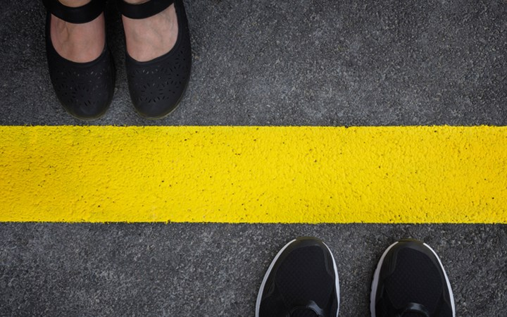 Yellow line with a pair of feet either side