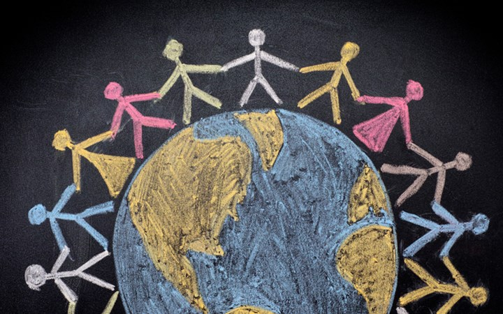 Chalk drawing of people holding hands around a world globe