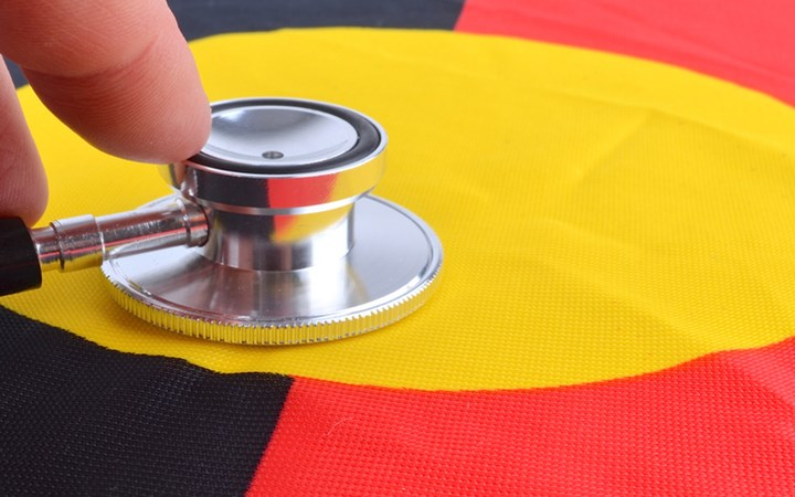 Stethoscope held to the Aboriginal flag