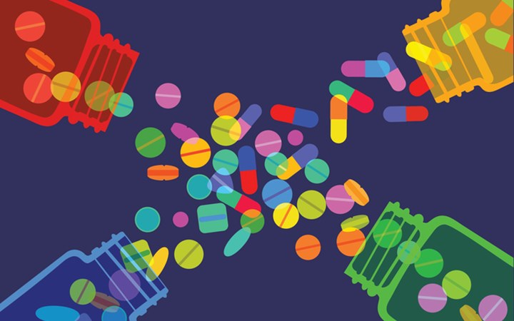 Medicines of a variety of colours spilling out of bottles